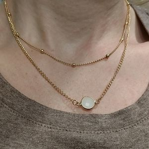 Ladies layered necklace, gold tone